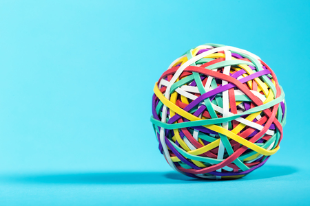 Elastic rubber band ball on a blue background