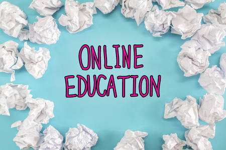 Online Education text with crumpled paper balls on a blue background