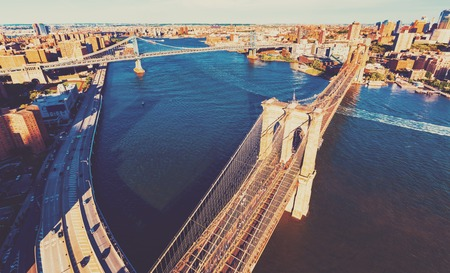 Aerial view of the Brooklyn Bridge over the East River in New York City
