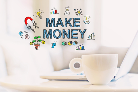 Make Money concept with a cup of coffee and a laptop