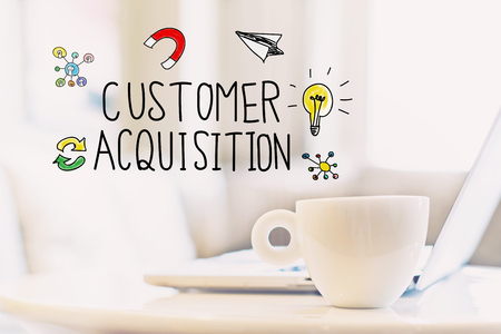 Customer Acquisition concept with a cup of coffee and a laptop Stock Photo