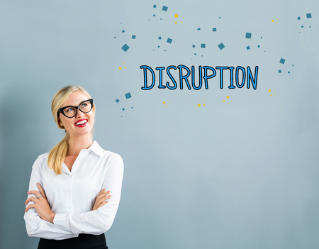 disruptive: Disruption text with business woman on a gray background Stock Photo