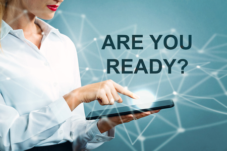 Are You Ready text with business woman using a tablet