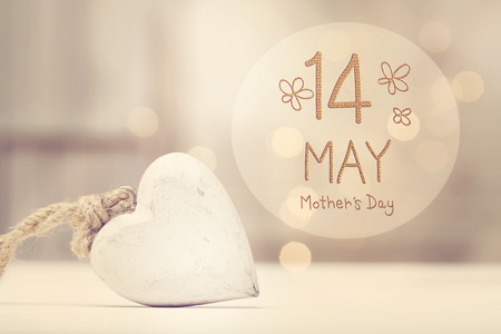 Mother's Day message with a white heart  in a room