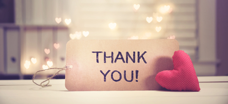 Thank You message with a red heart with heart shaped lights