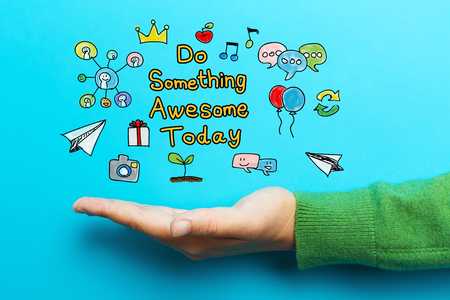 Do Something Awesome Today with hand on blue background