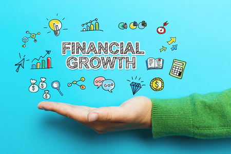 파란색 배경에 손으로 금융 성장 개념 스톡 콘텐츠