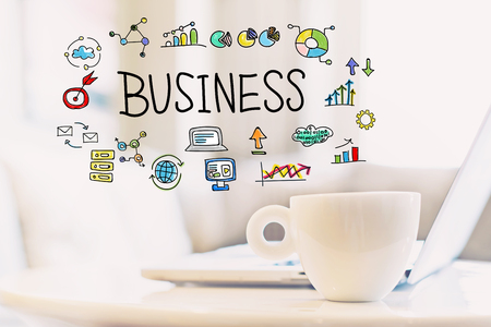 Business concept with a cup of coffee and a laptop