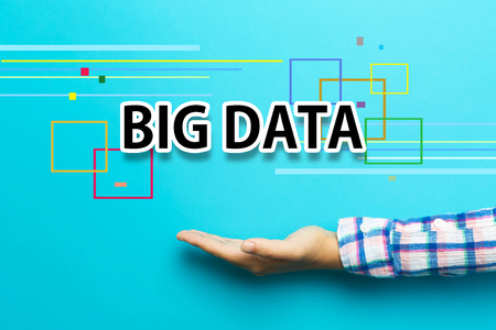Big Data concept with hand on blue background