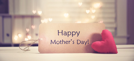 Mother's Day message with a red heart with heart shaped lights