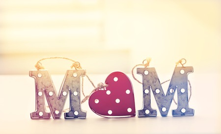 Mom letter ornaments on a table in a room Stock Photo - 77520214