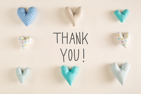 Thank You message with blue heart cushions on a white paper background Stock Photo - 77520221