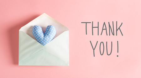 Thank You message with a blue heart cushion in an envelope Stock fotó