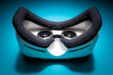futurist: Virtual reality headset device on a blue background
