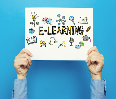 E-Learning text on a white poster on a blue background Stock Photo