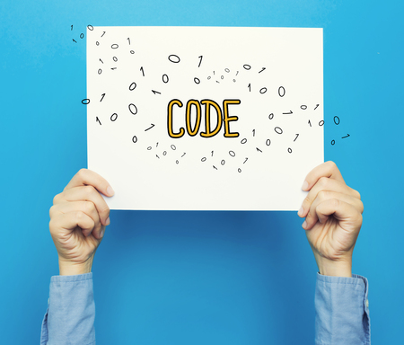 Code text on a white poster on a blue background