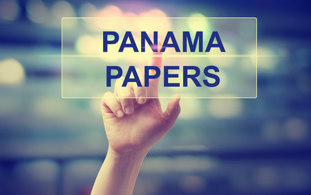 Panama Papers concept with hand pressing a button Stock Photo