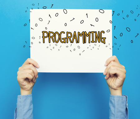 Programming text on a white poster on a blue background