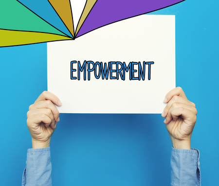 Empowerment text on a white poster on a blue background