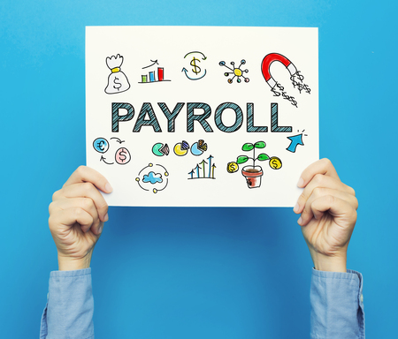 Payroll text on a white poster on a blue background