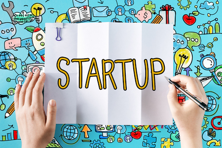 Startup text with hands and colorful illustrations