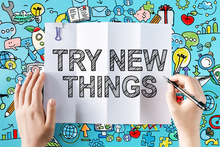 Try New Things text with hands and colorful illustrations