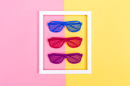Shutter shades sunglasses on a vibrant duotone background