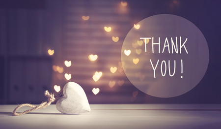 Thank You message with a white heart with heart shaped lights Stok Fotoğraf