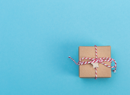Little handmade present box on a blue background