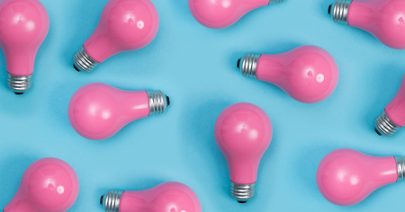 Pink painted lightbulbs on a blue background 스톡 콘텐츠 - 78340130