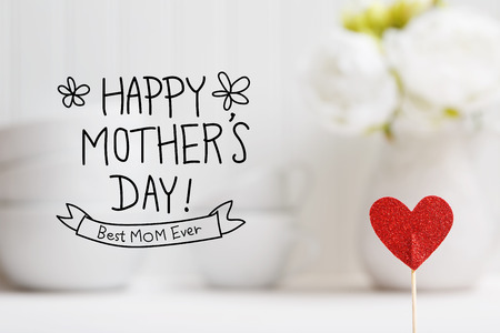 Mothers Day message with small red heart with white dishes Stock Photo - 78337686