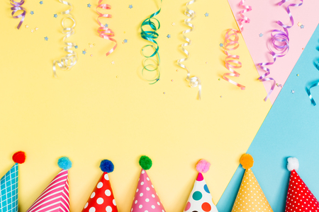 Party Theme With Hats And Streamers On A Vibrant Background Photo