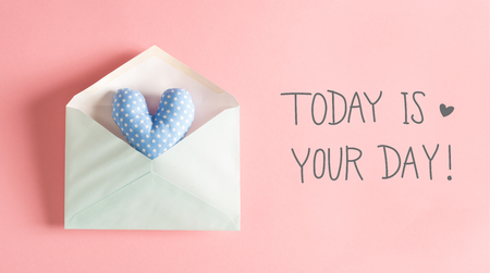 Today Is Your Day message with a blue heart cushion in an envelope