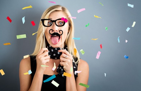 Happy woman celebrating with confetti party theme