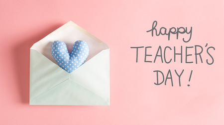 Teacher's Day message with a blue heart cushion in an envelope Banque d'images