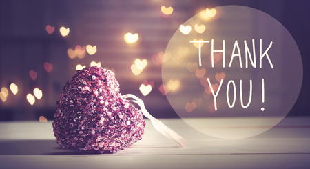 Thank You message with a pink heart with heart shaped lights