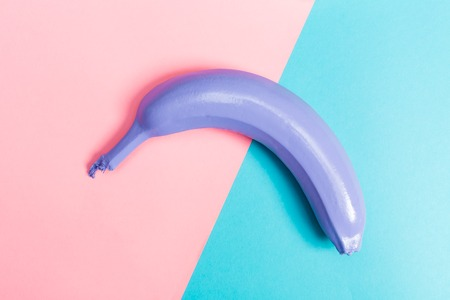 Painted banana on a bright split duotone background