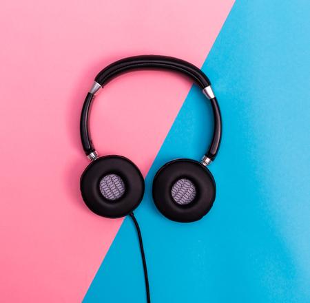 Headphones on a bright split duotone background Фото со стока