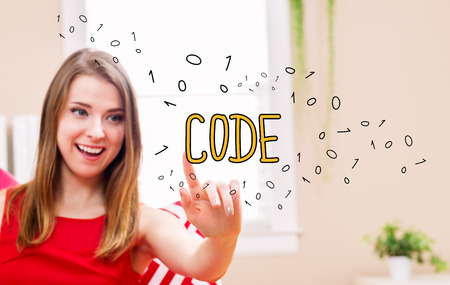 Code concept with young woman in her home Stock Photo