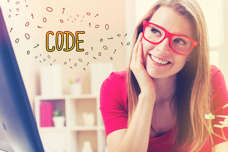 Code text with young woman in her home office