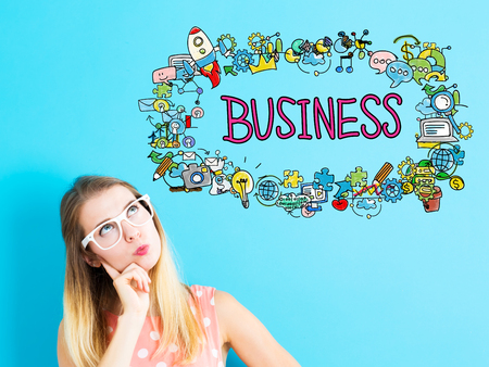 Business concept with young woman in a thoughtful pose