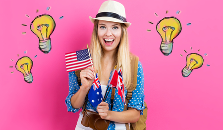 Light Bulbs illustration with young woman with flags of English speaking countries Stock Photo