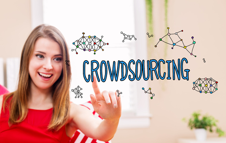 Crowdsourcing concept with young woman in her home Stock Photo