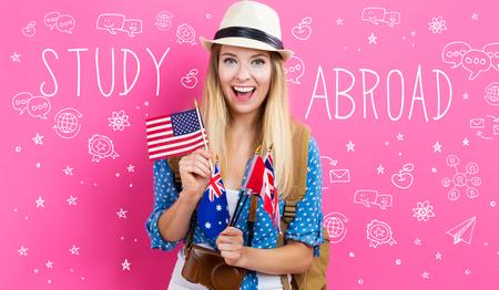 英語圏の国の国旗を持つ若い女性と海外本文 写真素材