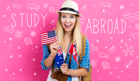 Study Abroad text with young woman with flags of English speaking countries Reklamní fotografie