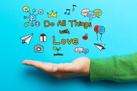 Do All Things with Love with hand on blue background