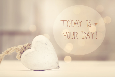 Today Is Your Day message with a white heart  in a room