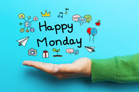 Happy Monday concept with hand on blue background Stock Photo