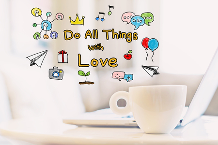 Do All Things With Love concept with a cup of coffee and a laptop Imagens