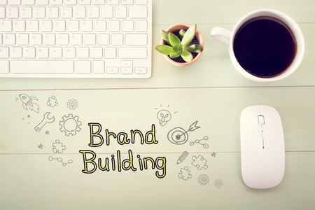 desk light: Brand Building concept with workstation on a light green wooden desk